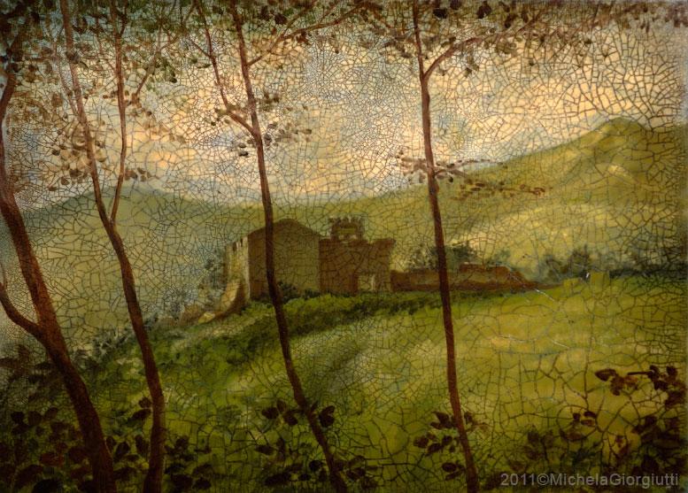 Craquelet con veduta tra i rami del castello di Caneva su collina verde