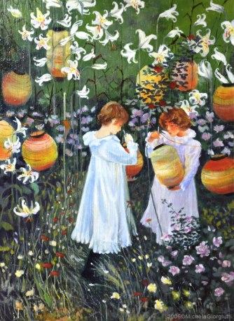Due bambine accendono lanterne in un giardino fiorito