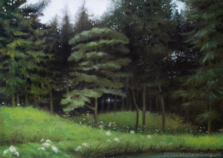 Veduta di bosco verde in riva al lago